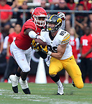 Rutgers takes on Iowa in their first Big Ten game of 2016 at High Point Solutions Stadium in Piscataway on Saturday September 24, 2016<br /> Rutgers # 2 (left) Kiy Hester can't strip the ball from Iowa's # 89 (right) Matt VaneBerg.
