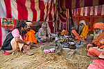 A Naga Sadhu in his tent at Kumbh Mela Festival. Naga Sadhus, the naked Sadhus of India, attract a large number of people to their tents during the Kumbh Mela 2013 at Allahabad.