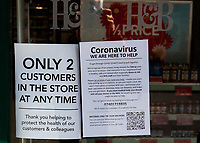 Notices in the window at Holland and Barrett in Sidcup, Kent during the Coronavirus (COVID-19) outbreak where travel has been restricted across the country at Sidcup, England on 25 March 2020. Photo by Alan Stanford/PRiME Media Images