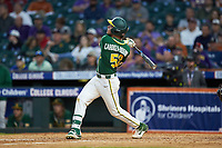 Esteban Cardoza-Oquendo (52) of the Baylor Bears follows through on his swing against the LSU Tigers in game five of the 2020 Shriners Hospitals for Children College Classic at Minute Maid Park on February 28, 2020 in Houston, Texas. The Bears defeated the Tigers 6-4. (Brian Westerholt/Four Seam Images)