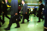 BUSINESS: TRANSPORT: JAPAN.Businessmen walking in rush at the train station in Japan...Photo by Richard Jones/sinopix.©sinopix