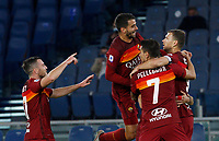 Roma s Edin Dzeko, right, celebrates with his teammates, from left, Jordan Veretout, Pedro and Lorenzo Pellegrini after scoring during the Serie A soccer match between Roma and Benevento at Rome's Olympic Stadium, October 18, 2020.<br /> UPDATE IMAGES PRESS/Riccardo De Luca