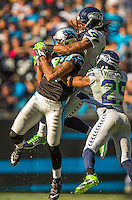 Sports action photography of the Carolina Panthers against the Seattle Seahawks during their NFL game at Bank of America Stadium in Charlotte, North Carolina.  <br /> <br /> Charlotte Photographer - Patrick SchneiderPhoto.com