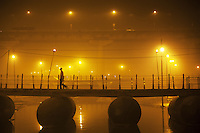 India. Uttar Pradesh state. Allahabad. Maha Kumbh Mela. A Indian Indu devotee crosses a pontoon bridge at night. The Kumbh Mela, believed to be the largest religious gathering is held every 12 years on the banks of the 'Sangam'- the confluence of the holy rivers Ganga, Yamuna and the mythical Saraswati. The Maha (great) Kumbh Mela, which comes after 12 Purna Kumbh Mela, or 144 years, is always held at Allahabad. Uttar Pradesh (abbreviated U.P.) is a state located in northern India. 11.02.13 © 2013 Didier Ruef