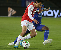 BOGOTA - COLOMBIA, 27-09-2020: Fabian Sambueza del Santa Fe disputa el balón con Andres Felipe Roman de Millonarios durante partido entre Independiente Santa Fe y Millonarios por la fecha 10 de la Liga BetPlay DIMAYOR I 2020 jugado en el estadio Nemesio Camacho El Campín de la ciudad de Bogotá. / Fabian Sambueza of Santa Fe vies for the ball with Andres Felipe Roman of Millonarios during match between Independiente Santa Fe and Millonarios for the date 10 as part of BetPlay DIMAYOR League I 2020 played at Nemesio Camacho El Campín stadium in Bogota city. Photo: VizzorImage / Daniel Garzon / Cont