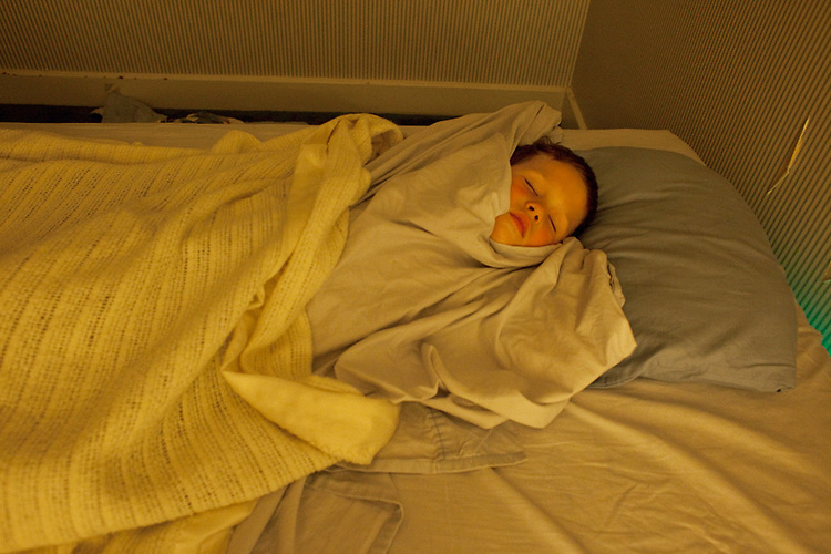 My older son, almost five, seen sleeping just before his late night potty break. He likes to wrap himself tightly in his blankets.