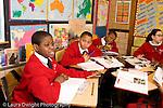 K-8 Parochial School Bronx New York Grade 5 male student responding to question horizontal