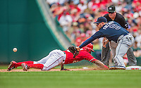 22 June 2014: Washington Nationals outfielder Denard Span dives safely back to first as Freddie Freeman attempts to catch the pickoff attempt by the Atlanta Braves at Nationals Park in Washington, DC. The Nationals defeated the Braves 4-1 to split their 4-game series and take sole possession of first place in the NL East. Mandatory Credit: Ed Wolfstein Photo *** RAW (NEF) Image File Available ***