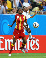 USA's Crystal Dunn (L) and Florence Dadson of Ghana during the FIFA U20 Women World Cup at the Rudolf Harbig Stadium in Dresden, Germany on July 14th, 2010.