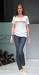 A model walks the runway during the 360 Project show at the first night of Fashion Houston at the Wortham Theater Monday Oct. 10,2011.(Dave Rossman/For the Chronicle)