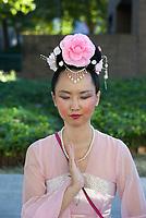 Beautiful Asian Woman Meditating, Seafair Torchlight Parade, Seattle, WA, USA.