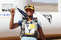 8th October 2021; Boulchrhal to Sud Jebel Irhfelt N'Tissalt ; Marathon des Sables, stage 5 and final stage of a six-day, 251 km ultramarathon, which is approximately the distance of six regular marathons. The longest single stage is 91 km long. This multiday race is held every year in southern Morocco, in the Sahara Desert. Aziz Raji (mor) celebrates as ladies winner of the event