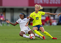 TOKYO, JAPAN - JULY 21: Crystal Dunn #2 of the USWNT tackles Sofia Jakobsson #10 of Sweden during a game between Sweden and USWNT at Tokyo Stadium on July 21, 2021 in Tokyo, Japan.