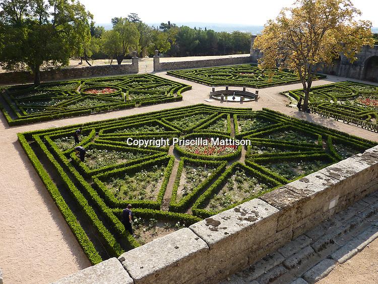 San Lorenzo de El Escorial, Spain - October 18, 2011 - A gardener tends the formal gardens of El Escorial.