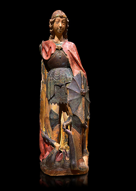 Gothic terracotta statue of the Archangel Gabriel attributed to Lorenzo Mercadante de Bretanya of Seville, circa 1460, from the convent of Santa Clara de Fregenal de la Sierra, Badajoz..  National Museum of Catalan Art, Barcelona, Spain, inv no: MNAC  4367. Against a black background.