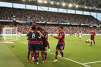 AUSTIN, TX - JULY 29: United States players including Gyasi Zardes #9, Nicholas Gioacchini #8, Sam Vines #3, Kellyn Acosta #23 of the United States, and Miles Robinson #12 celebrate a goal during a game between Qatar and USMNT at Q2 Stadium on July 29, 2021 in Austin, Texas.