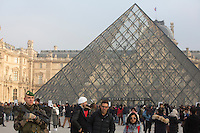 An armed French soldier patrols at the Louvre Museum as emergency security measures continue ahead of New Year's eve celebrations in and around the French capital, in Paris, France, December 30, 2016.