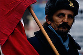 """Prague, Czechloslovakia<br /> November 27, 1989<br /> <br /> Anti-communist protester following the Velvet Revolution.<br /> <br /> The """"Velvet Revolution"""" (November 16 - December 29, 1989) refers to a non-violent revolution in Czechoslovakia that saw the overthrow of the Communist government.<br /> <br /> A peaceful student demonstration in Prague on November 17, 1989  was suppressed by riot police. That event sparked a series of popular demonstrations from November 19 to late December. By November 20 the number of peaceful protesters assembled in Prague had swelled from 200,000 the previous day to an estimated half-million. <br /> <br /> A two-hour general strike, involving all citizens of Czechoslovakia, was held on November 27.<br /> <br /> With the collapse of other Communist governments, and increasing street protests, the Communist Party of Czechoslovakia announced on November 28 that it would relinquish power and dismantle the single-party state. Barbed wire and other obstructions were removed from the border with West Germany and Austria in early December. ..On December 10, President Gustáv Husák appointed the first largely non-Communist government in Czechoslovakia since 1948, and resigned. Alexander Dubcek was elected speaker of the federal parliament on December 28 and Václav Havel the President of Czechoslovakia on December 29, 1989.<br /> <br /> In June 1990 the first democratic elections since 1946 were held in Czechoslovakia, resulting in the country's first completely non-Communist government in over forty years."""