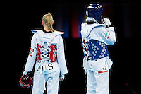 10 AUG 2012 - LONDON, GBR - Carmen Marton (AUS) (left) of Australia and Sousan Hajipourgoli of Iran wait for the referees decision after an appeal during their women's -67kg category preliminary round contest at the London 2012 Olympic Games Taekwondo at Excel in London, Great Britain .(PHOTO (C) 2012 NIGEL FARROW)