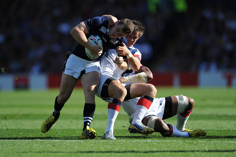 Mark Bennett of Scotland is tackled  during Match 18 of the Rugby World Cup 2015 between Scotland and USA - 27/09/2015 - Elland Road, Leeds<br /> Mandatory Credit: Rob Munro/Stewart Communications