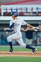 Jose Paez (2) of the Princeton Rays follows through on his swing against the Burlington Royals at Burlington Athletic Park on July 11, 2014 in Burlington, North Carolina.  The Rays defeated the Royals 5-3.  (Brian Westerholt/Four Seam Images)