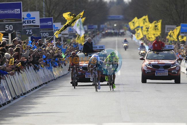 Tom Boonen (BEL) Omega Pharma-Quickstep outsprints Filippo Pozzato Farnese Vini-Selle Italia and Alessandro Ballan (ITA) BMC Racing Team to win the 96th edition of The Tour of Flanders 2012 , running 256.9km from Bruges to Oudenaarde, Belgium. 1st April 2012. <br /> (Photo by Eoin Clarke/NEWSFILE).