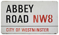 An iconic Abbey Road street sign has sold to a Beatles fan for £37,200 at auction.