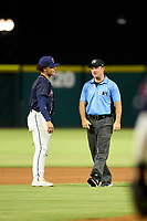 Jacksonville Jumbo Shrimp shortstop Bryson Brigman (6) questions a call with umpire Tom West during a game against the Memphis Redbirds on September 25, 2021 at 121 Financial Ballpark in Jacksonville, Florida.  (Mike Janes/Four Seam Images)