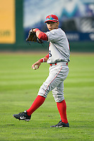 Spokane Indians shortstop Gabriel Roa #8 plays catch in the outfield prior to a game against the Everett AquaSox at Everett Memorial Stadium on June 20, 2012 in Everett, WA.  Everett defeated Spokane 9-8 in 13 innings.  (Ronnie Allen/Four Seam Images)