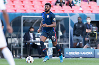 DENVER, CO - JUNE 3: Mark McKenzie #15 of the United States moves with the ball during a game between Honduras and USMNT at EMPOWER FIELD AT MILE HIGH on June 3, 2021 in Denver, Colorado.