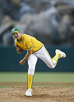 Barry Zito of the Oakland Athletics pitches during a 2002 MLB season game against the Los Angeles Angels at Angel Stadium, in Anaheim, California. (Larry Goren/Four Seam Images)