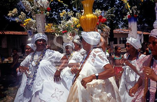 Itaparica, Brazil. Washing the Churches 'Lavagem das Igrejas' festival; Bahiana women with flowers.