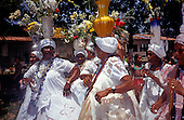 Itaparica, Brazil. Washing the Churches 'Lavagem das Igrejas' festival; Bahiana women with flowers.