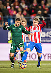 Riza Durmisi (l) of Real Betis Balompie fights for the ball with Kevin Gameiro of Atletico de Madrid during their La Liga 2016-17 match between Atletico de Madrid vs Real Betis Balompie at the Vicente Calderon Stadium on 14 January 2017 in Madrid, Spain. Photo by Diego Gonzalez Souto / Power Sport Images