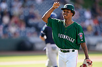 Brayan Bello (30) of the Greenville Drive, the Boston Red Sox No. 19 prospect, acknowledges the crowd's applause as he exits a game in which he struck out nine in 5.1 scoreless innings to earn his fifth win in a game against the Asheville Tourists on Sunday, June 6, 2021, at Fluor Field at the West End in Greenville, South Carolina. (Tom Priddy/Four Seam Images)