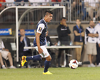 USMNT substitute midfielder Joe Corona (6) dribbles at midfield.  In CONCACAF Gold Cup Group Stage, the U.S. Men's National Team (USMNT) (blue/white) defeated Costa Rica (red/blue), 1-0, at Rentschler Field, East Hartford, CT on July 16, 2013.