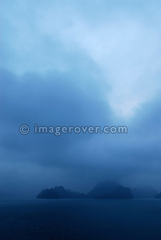 Asia, Vietnam, Halong Bay. Early morning on the Halong Bay. Designated a UNESCO World Heritage Site in 1994, the sensational Halong Bay is spread across 1.500 sq km, with more than 2.000 pinnacle shaped limestone and dolomite outcrops scattered across it. The impression is a labyrinthine seascape of bizarrly shaped outcrops, isolated caves, and sandy coves.