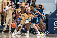 WASHINGTON, DC - FEBRUARY 8: Shawn Walker Jr. #1 of George Washington holds off Fatts Russell #1 of Rhode Island during a game between Rhode Island and George Washington at Charles E Smith Center on February 8, 2020 in Washington, DC.