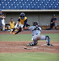 Adam Hackenberg of the Arizona League White Sox tags out Brewers baserunner Hedbert Perez in his first professional game at Maryvale Stadium on August 3, 2021 in Phoenix, Arizona (Bill Mitchell)