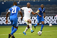 KANSASCITY, KS - JULY 11: Kamal Miller #4 of Canada with the ball during a game between Canada and Martinique at Children's Mercy Park on July 11, 2021 in KansasCity, Kansas.