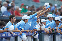 The North Carolina Tar Heels celebrate from their dugout during the game against the North Carolina State Wolfpack in Game Twelve of the 2017 ACC Baseball Championship at Louisville Slugger Field on May 26, 2017 in Louisville, Kentucky. The Tar Heels defeated the Wolfpack 12-4. (Brian Westerholt/Four Seam Images)