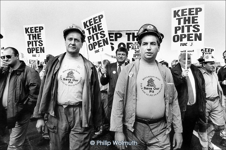 Miners from Houghton Main Colliery, in South Yorkshire, march through London to protest at government plans to close 19 coal mines. 30,000 miners' jobs are threatened by the proposals.