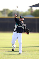 Alex Jackson #17 of the AZL Mariners warms up before a game against the AZL Giants at Peoria Sports Complex on July 10, 2014 in Peoria, Arizona. (Larry Goren/Four Seam Images)