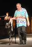 Ed McMahon walks a goat down the runway at the Citizens for Animal Protection owner/pet fashion show at the Hilton Americas Houston Saturday June 06,2009.(Dave Rossman/For the Chronicle)