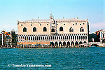 The main facade of Doge's Palace (Palazzo Ducale) seen from a vaporetto on a clear day in March. Includes a view of Ponte della Paglia with Ponte dei Sospiri behind in the shadow. Photo of Venice, Italy by Tomoko Yamamoto. Original on 35mm negative.