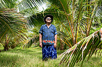Tuvalu farmer, Siaosi Finiki, 85, stands amongst his coconut trees in the northern end of Funafuti. Located in the South West Pacific Ocean, Tuvalu is the world's 4th smallest country and is one of the most vulnerable to climate change impacts including sea level rise, drought and extreme weather events. Tuvalu - March, 2019.