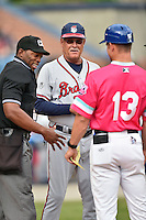 Home plate umpire Chris Lloyd, Rome Braves manager Randy Ingle (12) and Asheville Tourists manager Warren Schaeffer (13) before a game against the Rome Braves on May 15, 2015 in Asheville, North Carolina. The Braves defeated the Tourists 6-0. (Tony Farlow/Four Seam Images)
