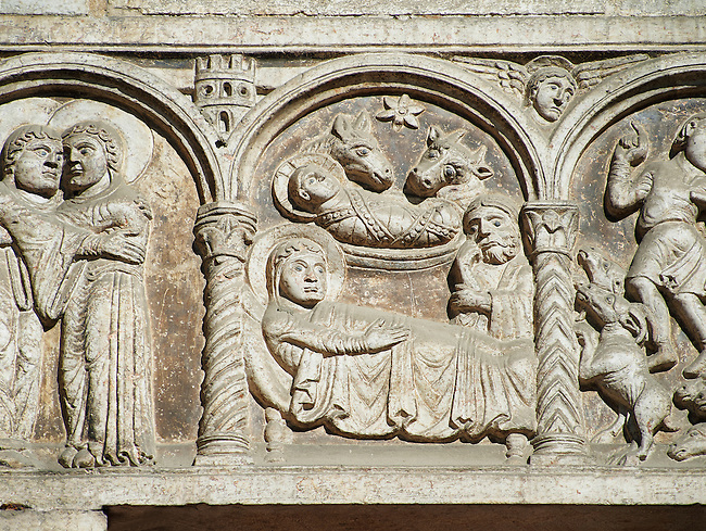 Scenes from the life of Christ - The Nativity - the work of the sculptor Nicholaus, on the main portal  of the 12th century Romanesque Ferrara Duomo, Italy