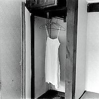 Woman's nightgown hanging in closet<br />