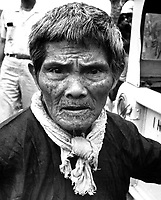 The strain shows clearly on the face of the Vietnamese, farmer, one of 4,500 who recently fled their homes to escape Vietcong harassment.  The refugees left hamlets which had been family homes for generations.  Ca. 1966.  (USIA)<br /> EXACT DATE SHOT UNKNOWN<br /> NARA FILE #:  306-MVP-22-11<br /> WAR & CONFLICT BOOK #:  408